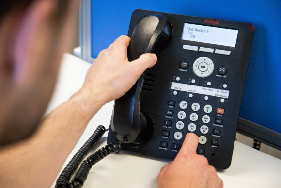 IT Engineer Installing VoIP telephones for businesses. Firstline IT Support. Oxford IT Solutions.