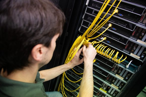 Image of IT Support Engineer Building IT Server with Cabling. Oxford IT Services and Support provided by First Line IT Oxford.