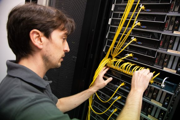 IT support engineer updating IT server. Technical IT support services in Oxford and the UK. Firstline IT Oxford.