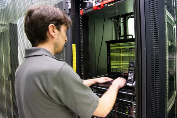Image of IT Support Engineer working on IT Server for Network Management, IT Security and Data Hosting.